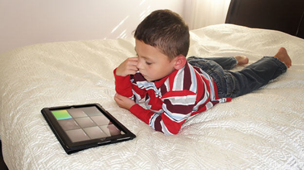 little boy playing on ipad